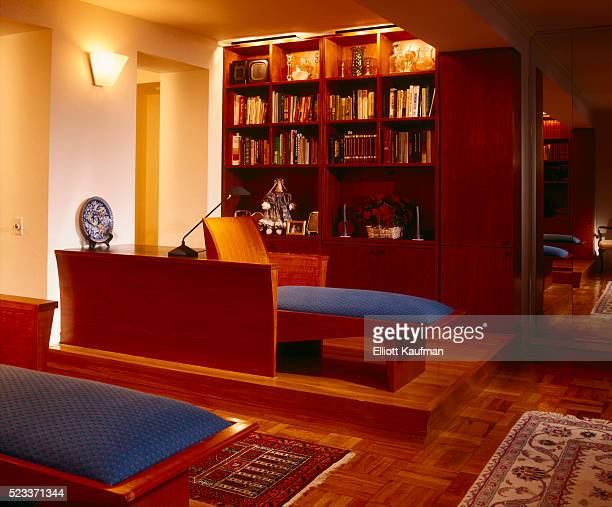 Built-in Chaise Longues and Bookcase in Library