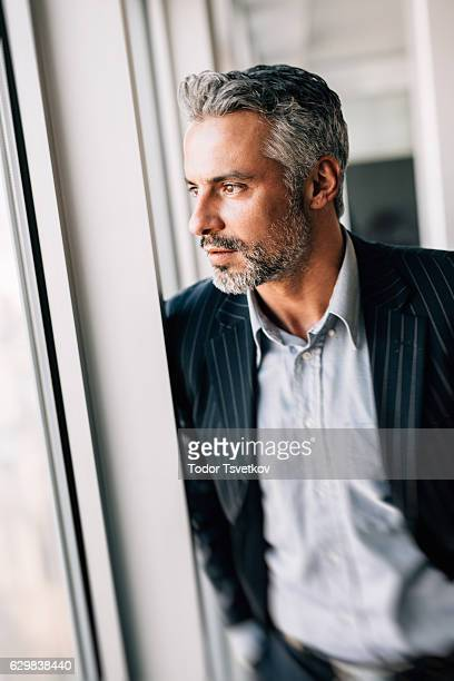 Buisnessman Looking Through The Window