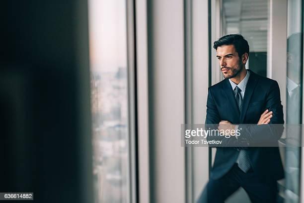 Buisnessman Looking Through The Window