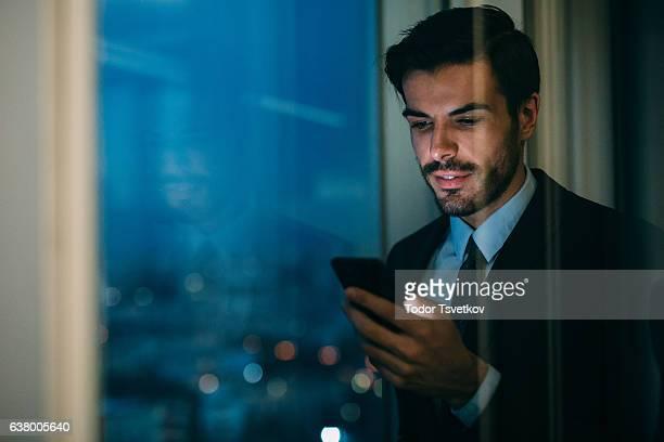 Buisnessman Texting On The Phone