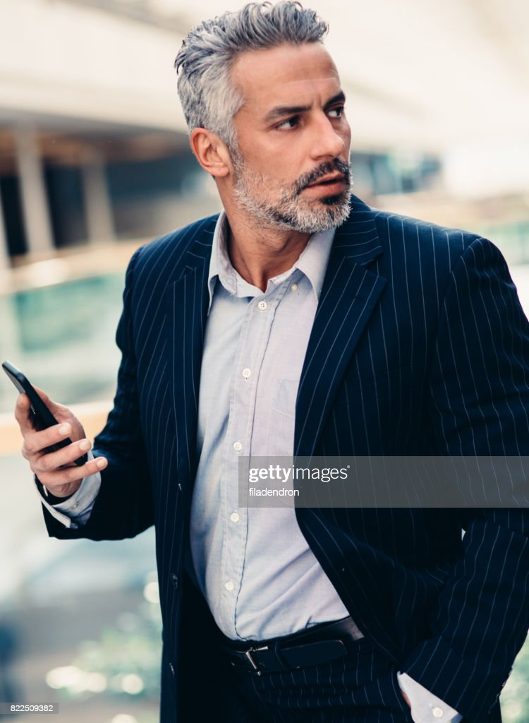 Buisnessman Texting On The Phone : Stock Photo