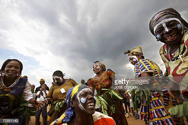 Supporters of Congo's outgoing President Joseph Kabila dance during a meeting 25 October 2006 at the stadium of Bukavu Democratic Republic of Congo...