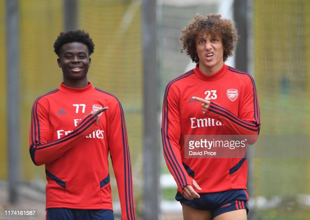 Bukayo Saka and David Luiz of Arsenal during the Arsenal Training Session at London Colney on September 12 2019 in St Albans England