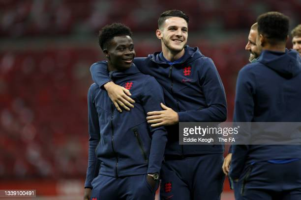 Bukayo Saka and Declan Rice of England interact as they inspect the pitch prior to the 2022 FIFA World Cup Qualifier match between Poland and England...