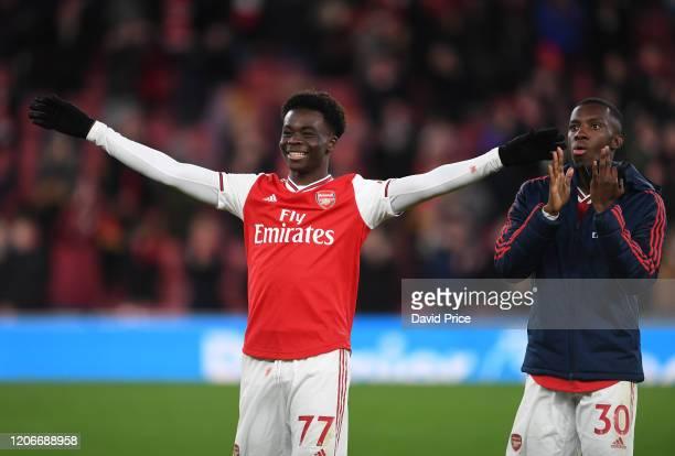 Bukayo Saka and Eddie Nketiah of Arsenal after the Premier League match between Arsenal FC and Newcastle United at Emirates Stadium on February 16,...