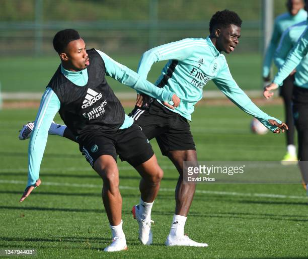 Bukayo Saka and Gabriel Magalhaes of Arsenal during the Arsenal 1st team training session at London Colney on October 21, 2021 in St Albans, England.