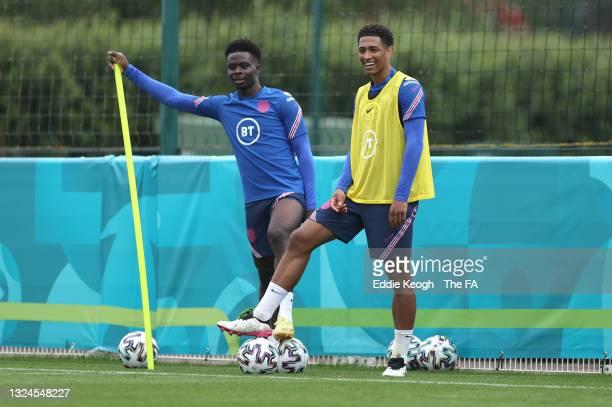 Bukayo Saka and Jude Bellingham of England look on at Tottenham Hotspur Training Ground on June 20, 2021 in Burton upon Trent, England.