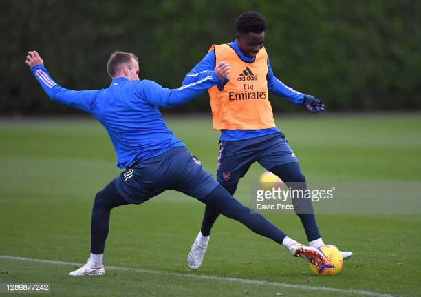 Bukayo Saka and Rob Holding of Arsenal during the Arsenal 1st team training session at London Colney on November 21 2020 in St Albans England