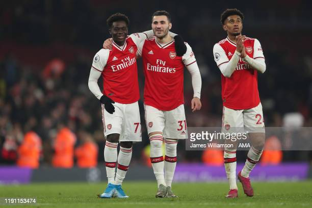 Bukayo Saka and Sead Kolasinac of Arsenal celebrate at full time of the Premier League match between Arsenal FC and Manchester United at Emirates...