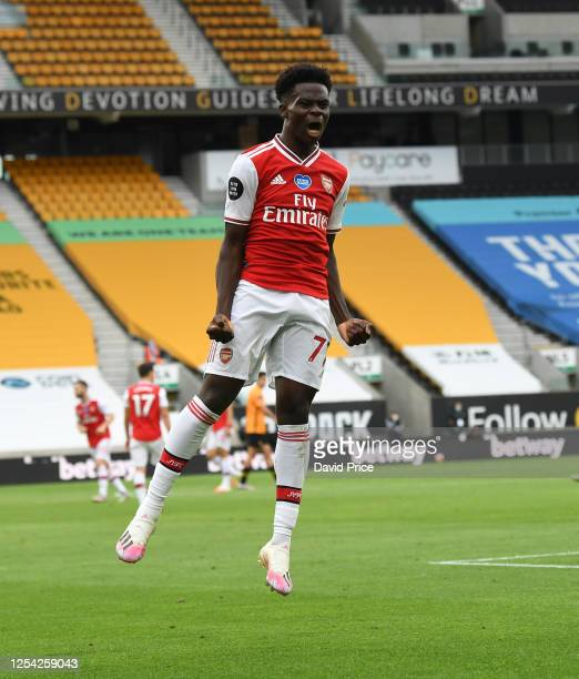 Bukayo Saka celebrates scoring a goal for Arsenal during the Premier League match between Wolverhampton Wanderers and Arsenal FC at Molineux on July...