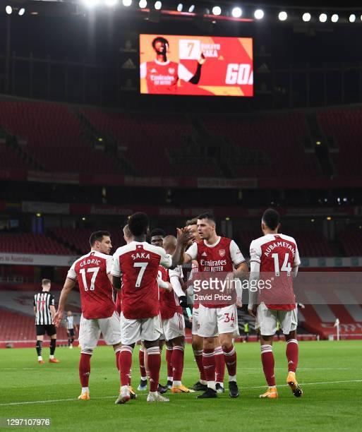 Bukayo Saka celebrates scoring Arsenal's 2nd goal with Granit Xhaka during the Premier League match between Arsenal and Newcastle United at Emirates...