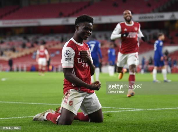 Bukayo Saka celebrates scoring Arsenal's 3rd goal during the Premier League match between Arsenal and Chelsea at Emirates Stadium on December 26,...