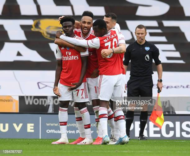 Bukayo Saka celebrates scoring for Arsenal with Pierre-Emerick Aubameyang, Eddie Nketiah and Granit Xhaka during the Premier League match between...