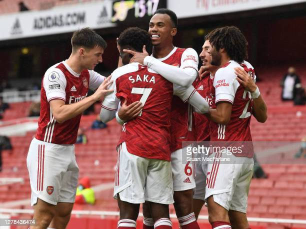 Bukayo Saka celebrates scoring the 1st Arsenal goal with Kieran TIerney and Gabriel during the Premier League match between Arsenal and Sheffield...