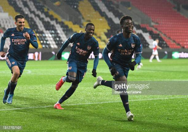 Bukayo Saka celebrates scoring the 3rd Arsenal goal with Dani Ceballos and Nicolas Pepe during the UEFA Europa League Quarter Final Second Leg match...