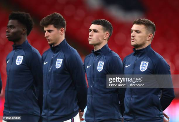 Bukayo Saka Mason Mount Phil Foden and Kieran Trippier line up ahead of the UEFA Nations League group stage match between England and Iceland at...