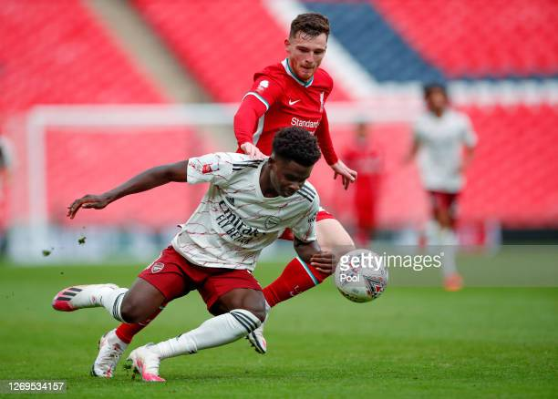 Bukayo Saka of Arsenal battles for possession with Andy Robertson of Liverpool during the FA Community Shield final between Arsenal and Liverpool at...
