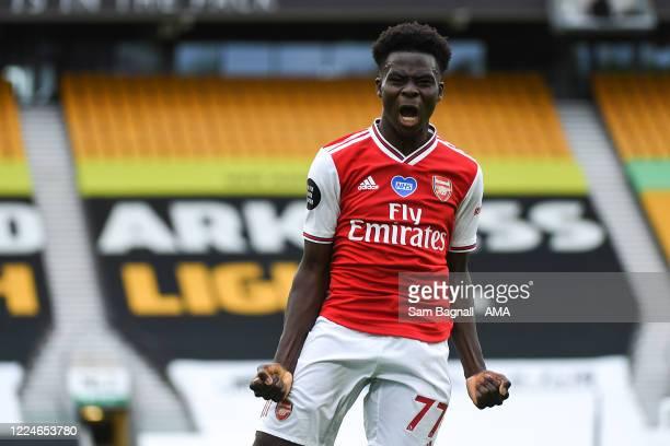 Bukayo Saka of Arsenal celebrates after scoring a goal to make it 0-1 during the Premier League match between Wolverhampton Wanderers and Arsenal FC...