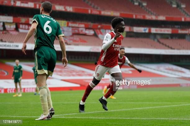 Bukayo Saka of Arsenal celebrates after scoring his sides first goal during the Premier League match between Arsenal and Sheffield United at Emirates...
