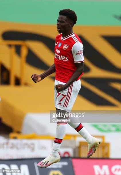 Bukayo Saka of Arsenal celebrates after scoring his team's first goal during the Premier League match between Wolverhampton Wanderers and Arsenal FC...