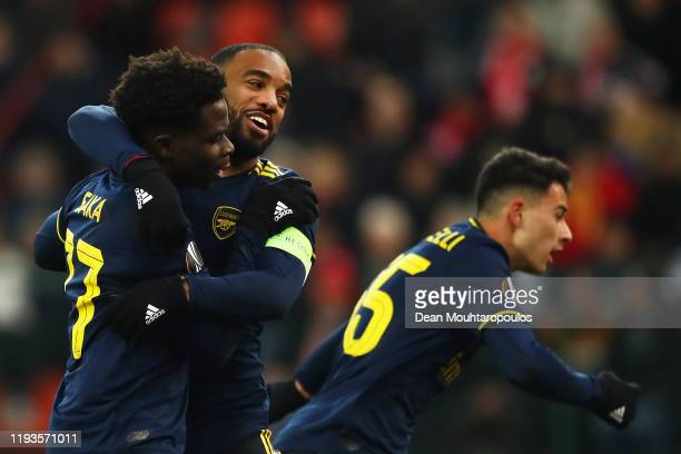 Bukayo Saka of Arsenal celebrates after scoring his team's second goal with teammate Alexandre Lacazette during the UEFA Europa League group F match...