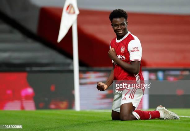 Bukayo Saka of Arsenal celebrates after scoring his team's third goal during the Premier League match between Arsenal and Chelsea at Emirates Stadium...