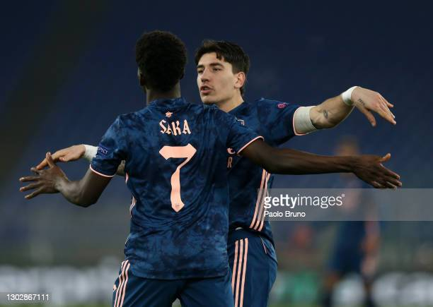 Bukayo Saka of Arsenal celebrates after scoring their sides first goal with team mate Hector Bellerin during the UEFA Europa League Round of 32 match...