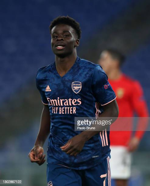 Bukayo Saka of Arsenal celebrates after scoring their sides first goal during the UEFA Europa League Round of 32 match between SL Benfica and Arsenal...