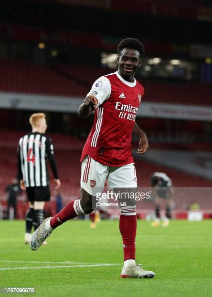 Bukayo Saka of Arsenal celebrates after scoring their team's second goal during the Premier League match between Arsenal and Newcastle United at...