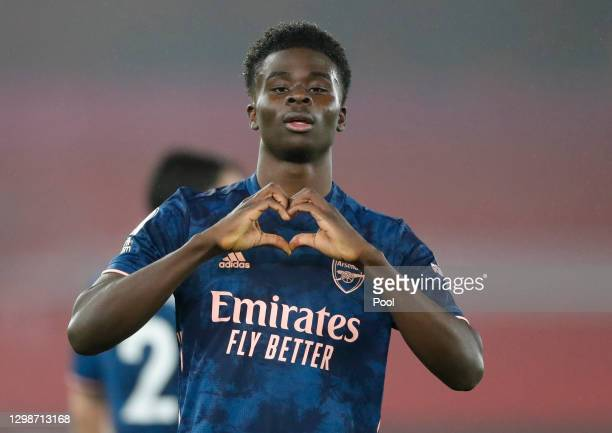 Bukayo Saka of Arsenal celebrates after scoring their team's second goal during the Premier League match between Southampton and Arsenal at St Mary's...