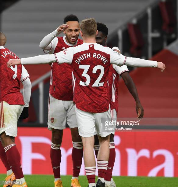Bukayo Saka of Arsenal celebrates scoring the second goal with Pierre-Emerick Aubameyang and Emile Smith Rowe during the Premier League match between...