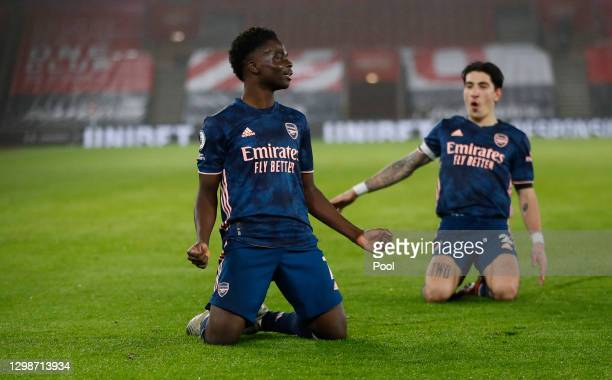 Bukayo Saka of Arsenal celebrates with Hector Bellerin after scoring their team's second goal during the Premier League match between Southampton and...