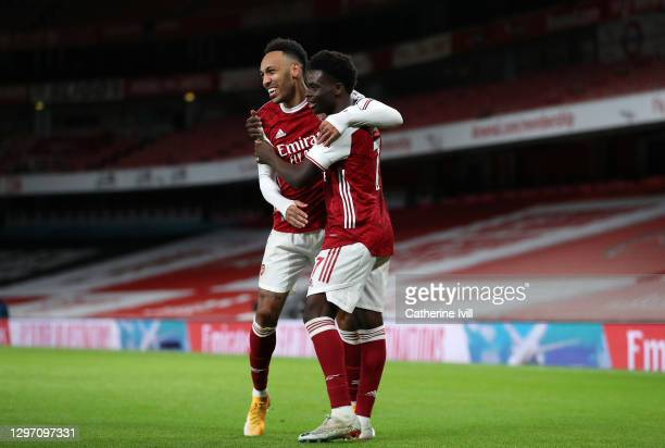 Bukayo Saka of Arsenal celebrates with teammate Pierre-Emerick Aubameyang after scoring their team's second goal during the Premier League match...
