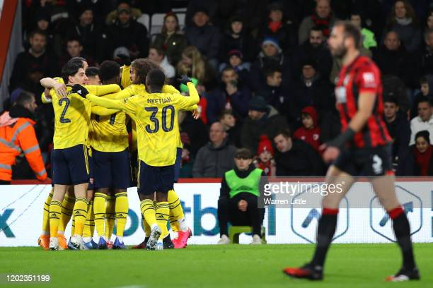 Bukayo Saka of Arsenal celebrates with teammates after scoring his team's first goal during the FA Cup Fourth Round match between AFC Bournemouth and...