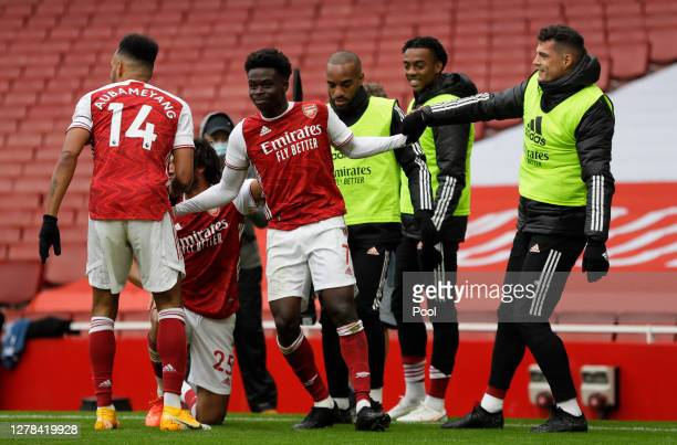 Bukayo Saka of Arsenal celebrates with teammates after scoring his sides first goal during the Premier League match between Arsenal and Sheffield...