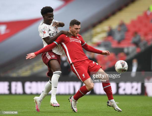 Bukayo Saka of Arsenal challenges Andrew Robertson of Liverpool during the FA Community Sheild match between Arsenal and Liverpool at Wembley Stadium...