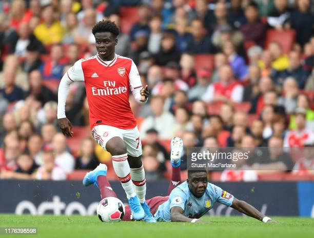 Bukayo Saka of Arsenal controls the ball during the Premier League match between Arsenal FC and Aston Villa at Emirates Stadium on September 22 2019...