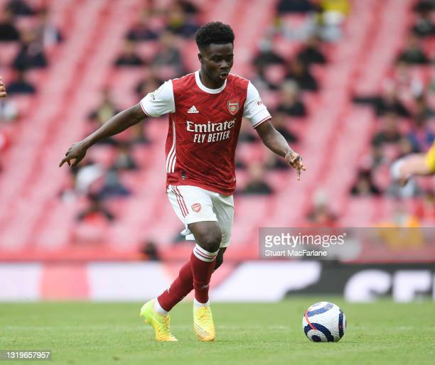 Bukayo Saka of Arsenal during the Premier League match between Arsenal and Brighton & Hove Albion at Emirates Stadium on May 23, 2021 in London,...