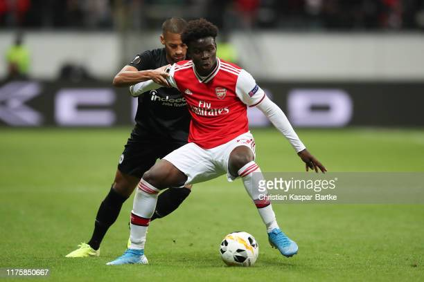 Bukayo Saka of Arsenal FC challenges Djibril Sow of Eintracht Frankfurt during the UEFA Europa League group F match between Eintracht Frankfurt and...