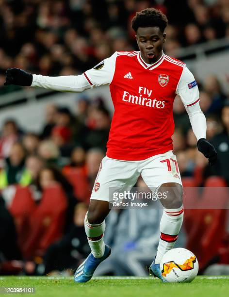 Bukayo Saka of Arsenal FC controls the ball during the UEFA Europa League round of 32 second leg match between Arsenal FC and Olympiacos FC at...