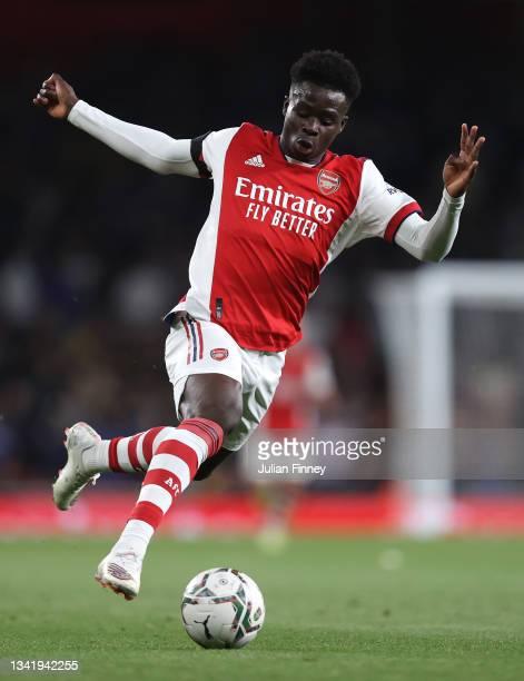 Bukayo Saka of Arsenal in action during the Carabao Cup Third Round match between Arsenal and AFC Wimbledon at Emirates Stadium on September 22, 2021...