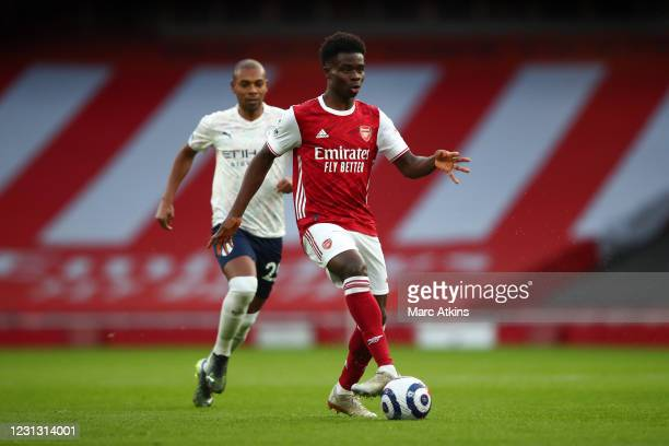 Bukayo Saka of Arsenal in action with Fernandinho of Manchester City during the Premier League match between Arsenal and Manchester City at Emirates...