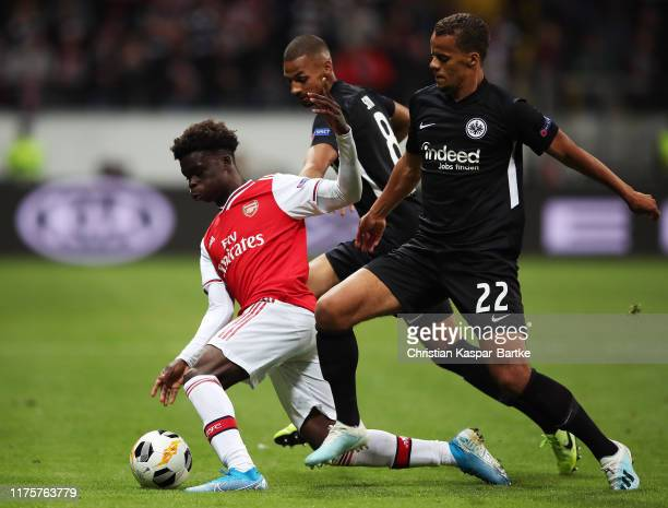 Bukayo Saka of Arsenal is challenged by Timothy Chandler of Eintracht Frankfurt during the UEFA Europa League group F match between Eintracht...