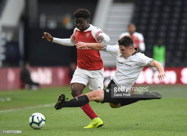 Bukayo Saka of Arsenal is fouled by Eiran Cashin of Derby during the match between Derby County U18 and Arsenal U18 in the U18 Premier League Play...