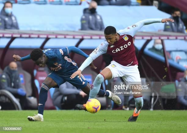 Bukayo Saka of Arsenal is fouled by Ezri Konsa Nhoyo of Aston Villa during the Premier League match between Aston Villa and Arsenal at Villa Park on...