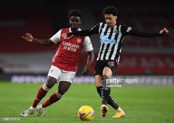 Bukayo Saka of Arsenal is fouled by Jamal Lewis of Newcastle during the Premier League match between Arsenal and Newcastle United at Emirates Stadium...