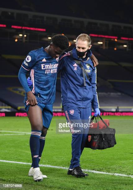Bukayo Saka of Arsenal is substituted after receiving medical treatment during the Premier League match between Leeds United and Arsenal at Elland...