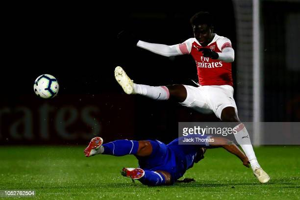 Bukayo Saka of Arsenal is tackled by Tyias Browning of Everton during the Premier League 2 match between Arsenal and Everton at Meadow Park on...