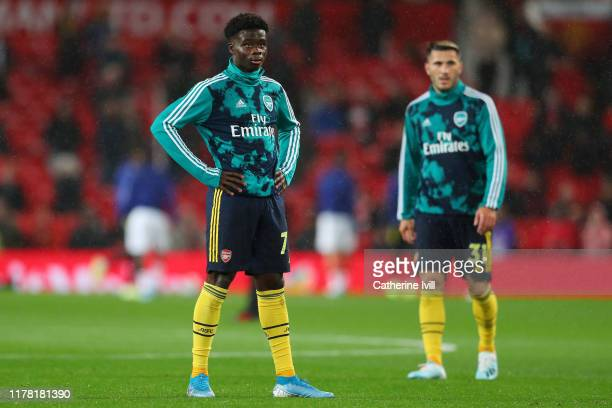 Bukayo Saka of Arsenal looks on during warming up with his team ahead of the Premier League match between Manchester United and Arsenal FC at Old...
