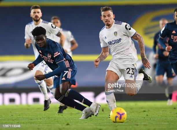 Bukayo Saka of Arsenal passes the ball under pressure from Kalvin Phillips of Leeds during the Premier League match between Leeds United and Arsenal...